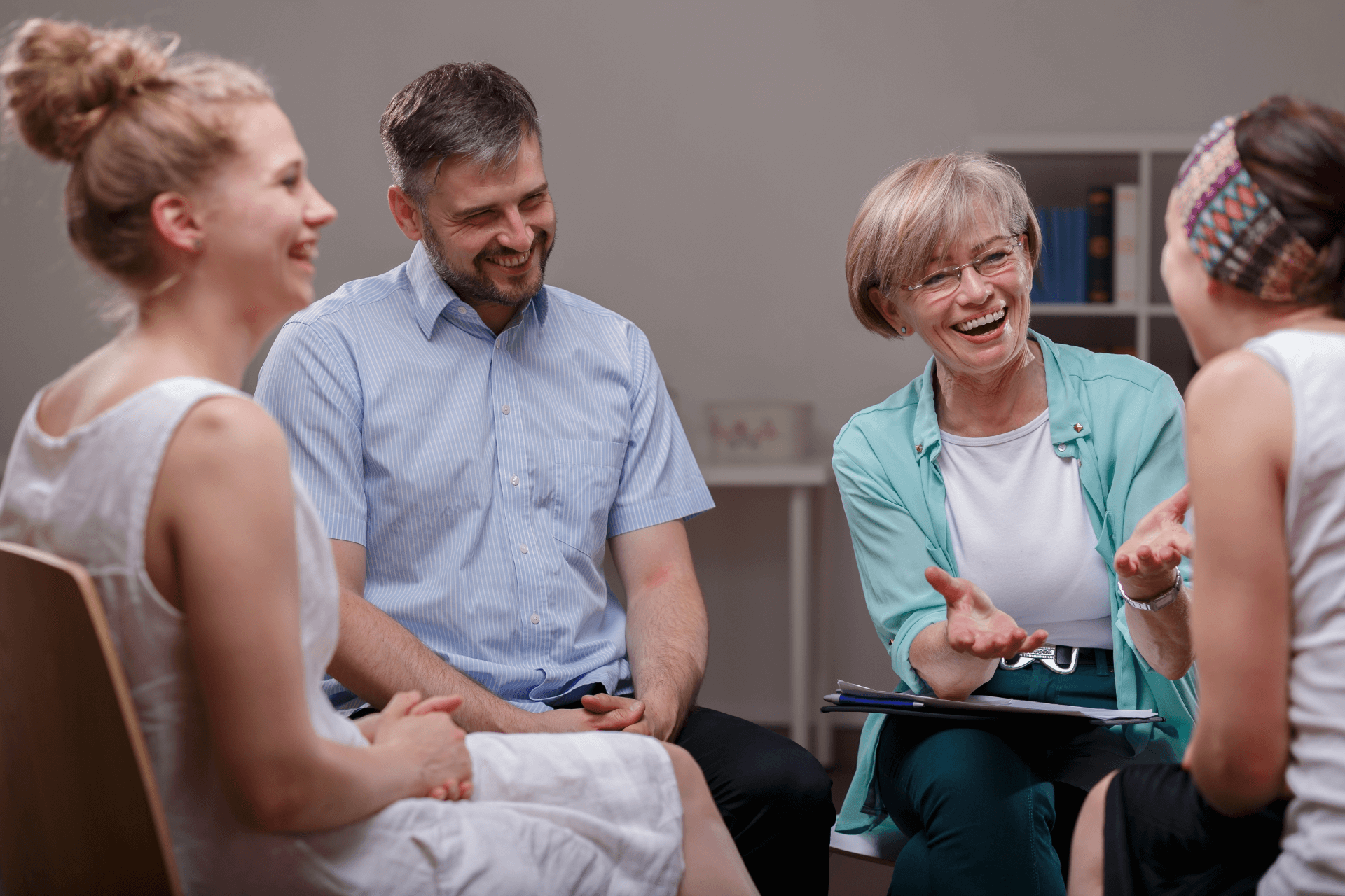 Group of people in a support session laughing