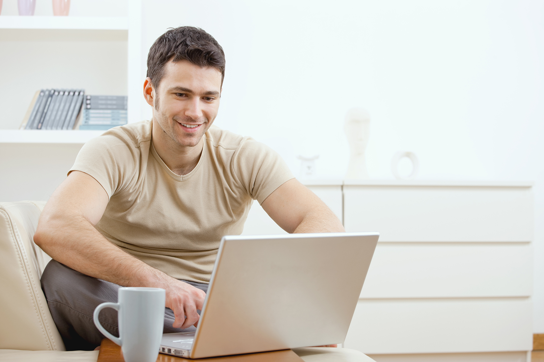 Male looking at a laptop