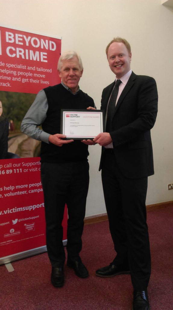 Volunteer Michael recieving an award